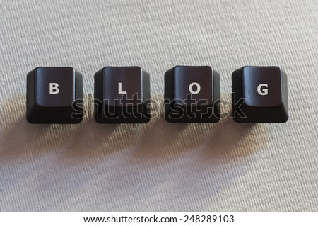 The word blog made of four black computer keyboard buttons - stock photo