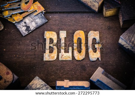 The word blog written in rusted metal letters surrounded by vintage wooden and metal letterpress type. - stock photo