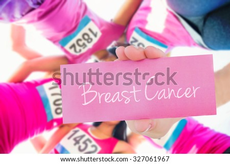 The word breast cancer and young woman holding blank card against five smiling runners supporting breast cancer marathon - stock photo