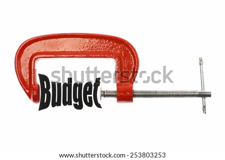 """The word """"Budget"""" is compressed with a vice. Business metaphor. - stock photo"""