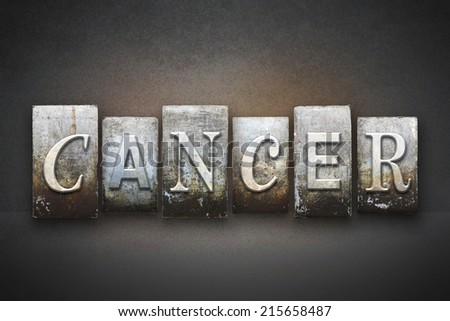 The word CANCER written in vintage letterpress type - stock photo