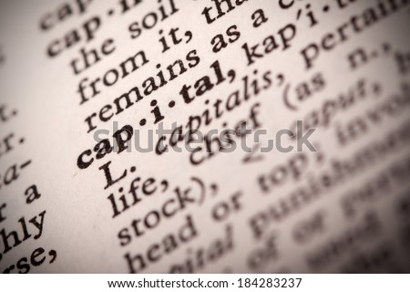 """The word """"Capital"""" in a dictionary - stock photo"""
