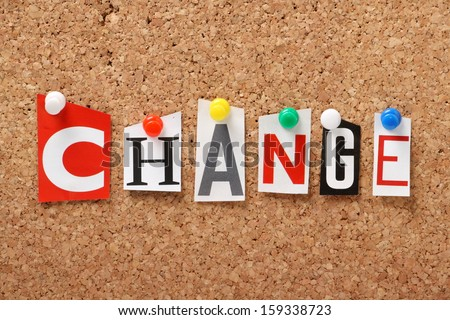 The word Change in cut out magazine letters pinned to a cork notice board - stock photo