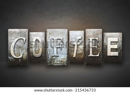 The word COFFEE written in vintage letterpress type - stock photo