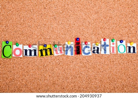 The word Communication in cut out magazine letters pinned to a cork notice board - stock photo