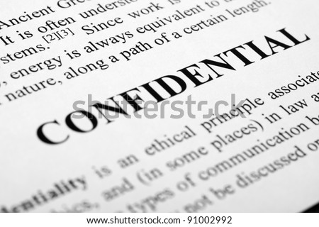 The word confidential shot with artistic selective focus. - stock photo