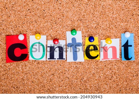 The word content in cut out magazine letters pinned to a cork notice board - stock photo