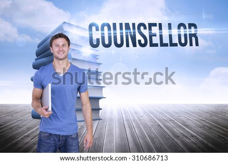 The word counsellor and smiling man with closed laptop against stack of books against sky - stock photo