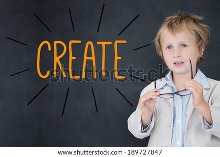 The word create against schoolboy and blackboard - stock photo