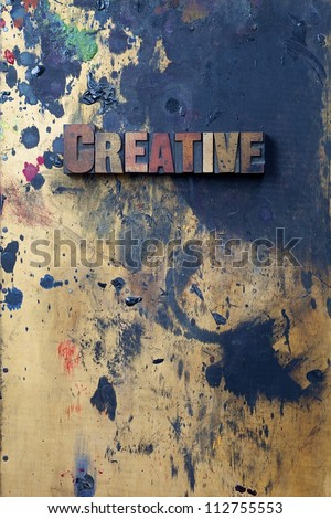 The word creative written in antique letterpress printing blocks. - stock photo