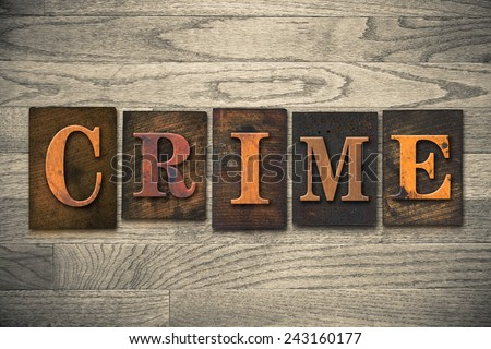 "The word ""CRIME"" written in wooden letterpress type. - stock photo"