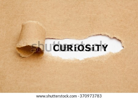 The word Curiosity appearing behind torn brown paper. Curiosity is the desire to learn or know more about something or someone. - stock photo