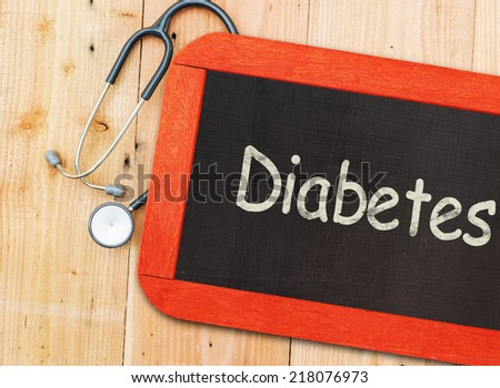 The word Diabetes written on chalkboard and stethoscope. - stock photo