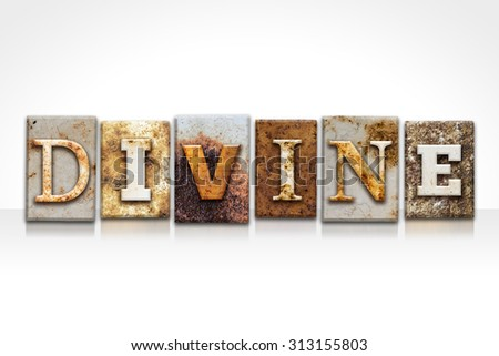 "The word ""DIVINE"" written in rusty metal letterpress type isolated on a white background. - stock photo"
