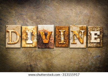 "The word ""DIVINE"" written in rusty metal letterpress type on an old aged leather background. - stock photo"
