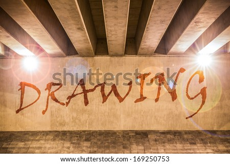 The word drawing painted as graffiti on the support column of an overpass - stock photo