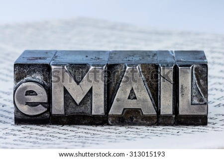 """the word """"e-mail"""" in lead letters written. symbolic photo for fast correspondence - stock photo"""