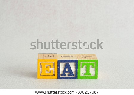 The word eat spelled with colorful alpahbet block isolated on a white background - stock photo