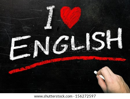 The word English handwritten in white chalk on a used blackboard  - stock photo