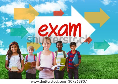 The word exam and smiling little school kids in school corridor against green field under blue sky - stock photo