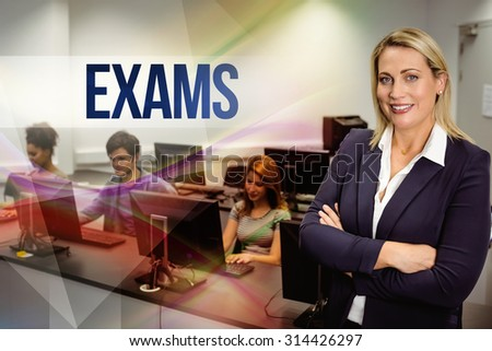 The word exams against computer teacher smiling at camera with arms crossed - stock photo