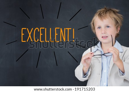 The word excellent! against schoolboy and blackboard - stock photo