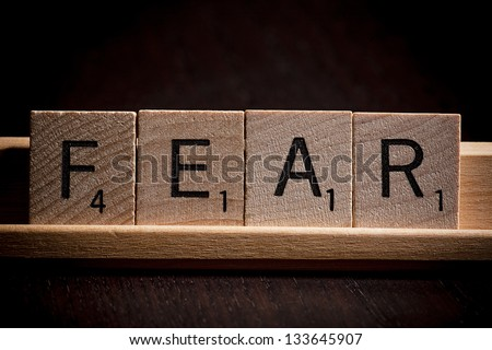 the word fear spelled by wooden scrabble letters - stock photo