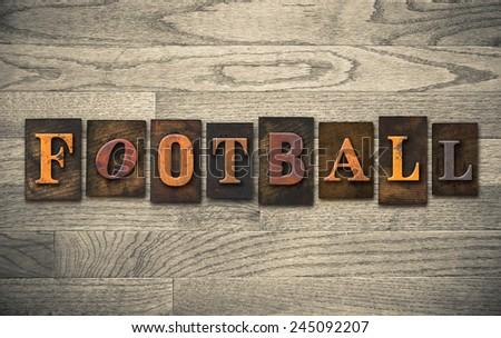 "The word ""FOOTBALL"" written in vintage wooden letterpress type. - stock photo"