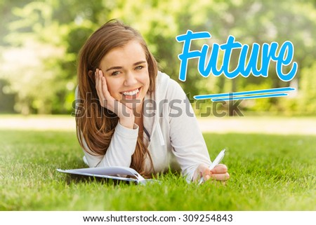 The word future against smiling university student lying and writing on notepad - stock photo