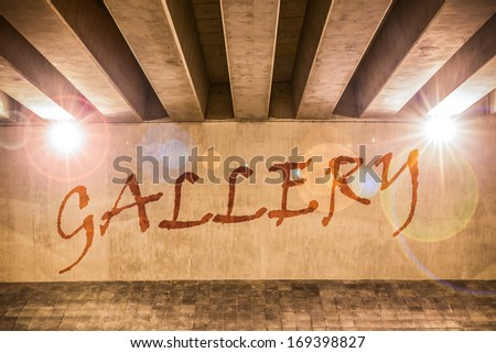 The word gallery painted as graffiti on the support column of an overpass - stock photo
