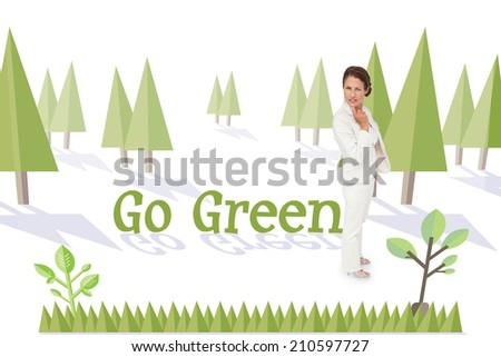The word go green and thinking businesswoman against forest with earth tree - stock photo