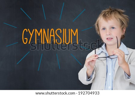 The word gymnasium against schoolboy and blackboard - stock photo