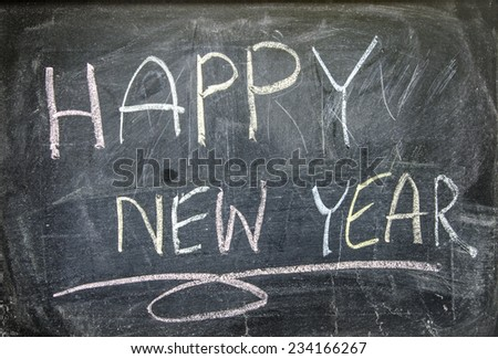 "The word ""HAPPY NEW YEAR"" written on blackboard  - stock photo"