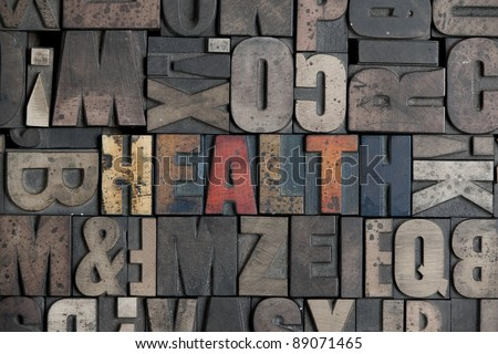 The word Health written in very old letterpress type - stock photo