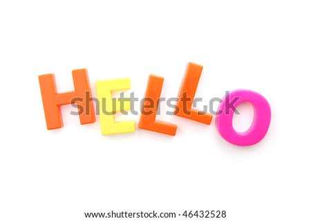 The word 'hello' spelled out using colored fridge magnets, isolated on white - stock photo