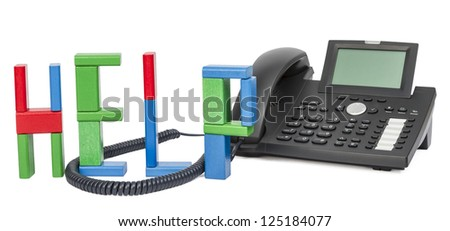 the word help made with toy bricks and a business phone in background. - stock photo