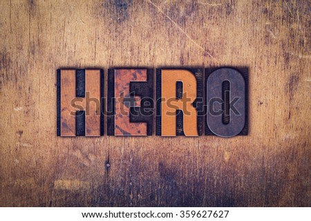 """The word """"Hero"""" written in dirty vintage letterpress type on a aged wooden background. - stock photo"""