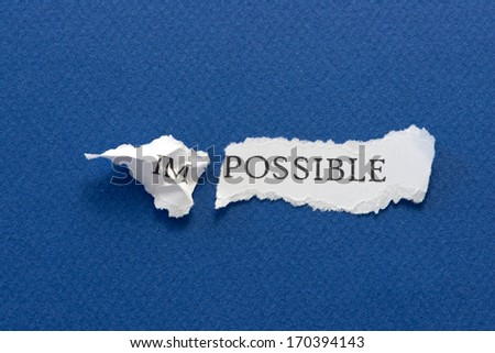 The word impossible torn in two parts, im and possible - stock photo