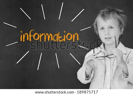 The word information against schoolboy and blackboard - stock photo