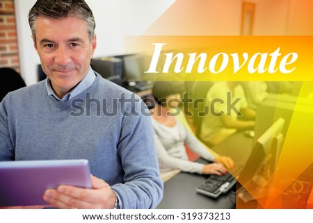 The word innovate against teacher holding a tablet pc - stock photo
