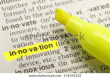The Word Innovation Highlighted in Dictionary with Yellow Marker Highlighter Pen. - stock photo