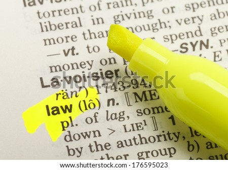 The Word Law Highlighted in Dictionary with Yellow Marker Highlighter Pen. - stock photo