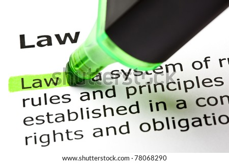 The word Law highlighted in green with felt tip pen. - stock photo