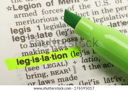 The Word Legislation Highlighted in Dictionary with Yellow Marker Highlighter Pen. - stock photo