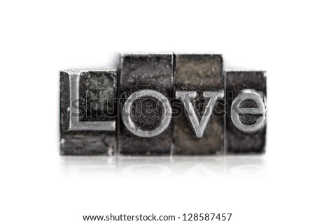 "The word ""love"" in letterpress type on white background - Macro - stock photo"