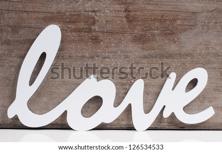 The word Love on a wooden background - stock photo