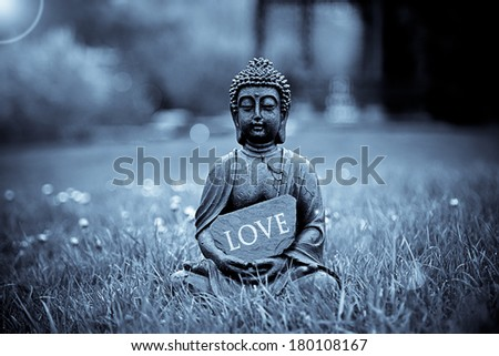 The word Love with Buddha Statue - stock photo
