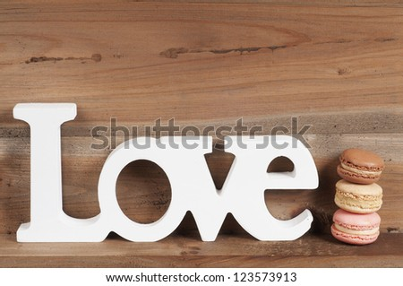 The word love with macaroons - stock photo