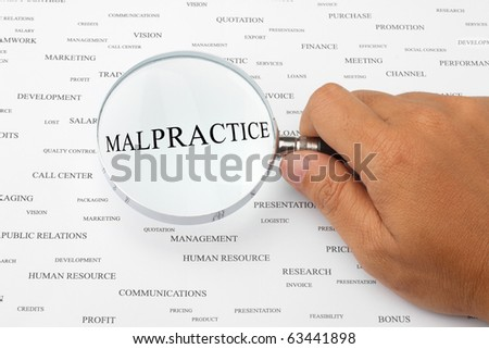 The word MALPRACTICE is magnified. - stock photo
