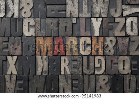 The word March written in antique letterpress printing blocks. - stock photo